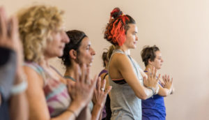 hands to heart center starting yoga class