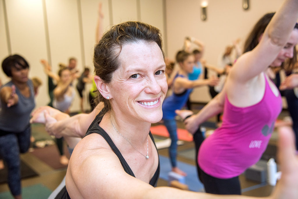 smiling during yoga class